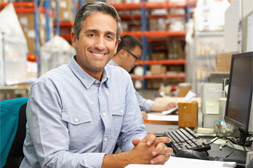 man sitting in warehouse
